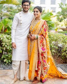 These Gorgeous Brides In Sarees Is The Best Thing You'll See Today - Beautiful traditional yellow Neeta Lulla Paithani wedding saree. Couple Wedding Dress, Wedding Dresses Men Indian, Wedding Outfits For Groom, Groom Wedding Dress, Indian Wedding Couple, Indian Bridal Outfits, Indian Bridal Fashion, Groom Dress, Saree Wedding