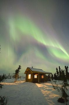 The aurora lights in Alaska shine brightly above The Gates Of The Arctic National Park :) I so want a night in this cute cabin. A chair outside, a cup of hot chocolate...this is how memories are made :)