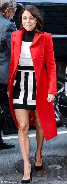 eb2c278a979 Bethenny Frankel is a mom on the move in bright red coat