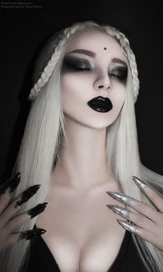 Black lipstick and eyeliner. Love the black and silver dipped fingertips.