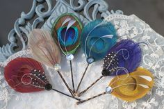 Peacock feather hair accessories - this seems rather simple in design and could be a cute accessory for myself and my bridesmaids. :)