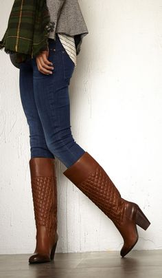 Genuine leather knee-high boots with quilted detailing a block heel side zipper and rounded toe. Note: Brown leather has distressed touches at toe and heel.