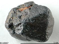 Davidite-(La), La(Y,U)Fe2(Ti,Fe,Cr,V)18(O,OH,F)38, Billeroo Davidite Prospect, Plumbago Station, Olary Province, South Australia, Australia. Black worn octahedron (metamict)