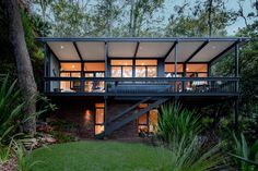 Brian Mazlin built this beach house in 1963 with a restoration and new interiors by TFAD in 2010. This Australian beach house would be a perfect get away or