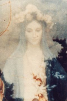 Virgin Mary .... Extraordinary photo of the Virgin Mary that miraculously appeared on the film of a camera owned by a priest who was taking a picture of the interior of a church.