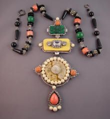 VRBA  Deco style pendant necklace  with glass stations, carved peach beads and clear rhinestones pendant on a  necklace of black, coral and green glass beads with rhinestone rondelles,  pendant 9 by 4 and wearable length of 28. Need I say this is a very LARGE  necklace!