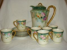 Each cup and saucer is a little different from the rest. set includes: pitcher with lid 6 saucers 7 cups Items we sell are assumed to be in used condition u Vintage Dishes, Vintage China, Vintage Tea, Tea Cup Saucer, Tea Cups, China Tea Sets, Art Deco, Cute Mugs, Chocolate Pots