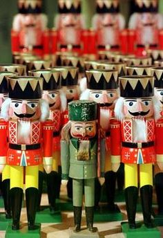 "NUTCRACKERS~One classic nutcracker is still made today after the 1870's original by Wilhelm Friedrich Fuchtner of Seiffen, a picturesque town in the Erzgebirge well known for it's talented toymaking citizens. Known as the ""father of the nutcracker"" Fuchtner launched the first commercial production of these wooden figures, turning the figures on a lathe instead of whittling them by hand."