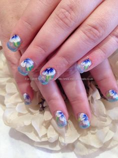 Light blue French tip manicure with blue and white 1 / one stroke technique flowers nail art free hand floral