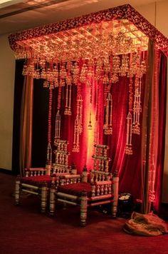Wedding Stage Decor   WedMeGood Deep Crimson Red & Gold Stage with Hanging Kaleere Decor. #wedmegood #wmgdecor