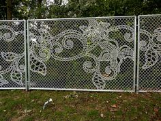 Joep Verhoeven a Dutchman, has designed a chain link fence that incorporates lace designs into the fence. The lace fence is produced by the Dutch design house, Demakersvan, and is available in the U. Fence Art, Metal Fence, Wire Fence, Chain Link Fence, Yarn Bombing, Fence Design, Garden Design, Garden Gates, Yard Art