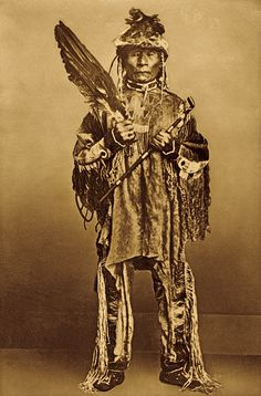 Photographed in native dress during a Nez Perce delegation to Washington, D.C. in 1868, Chief Kalkalshuatash holds a feather fan and pipe. After meeting with the government to restore the provisions of an 1863 treaty, his people still fell victim to funds squandered by government officials.  – Courtesy Smithsonian Institution Bureau of American Ethnology –