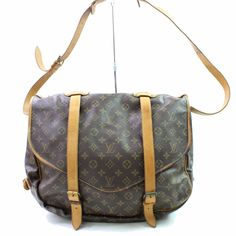 f6ed7371bfff Second-hand Saumur cloth handbag Louis Vuitton Brown in Cloth available.  eModaOutlet