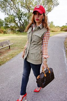 cargo vest and gingham shirt, speedy 30, red pumps, black ripped knee jeans, green cargo vest, plaid shirt, red hat