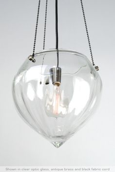 MALMÖ PENDANT: hand-blown glass suspended by a cast bronze canopy, beaded chain and cloth covered fabric cord