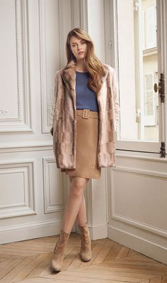 Two of our favorites from the collection: The stunning faux fur coat paired with the soft suede A-line skirt $395 (Sizes 00-16) Visit our page to order: www.etceteracomestoyou.com