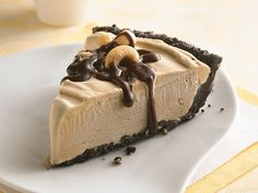 Coffee Ice Cream Pie with a crust made of chocolate wafers, coconut & chopped cashews or macadamia nuts