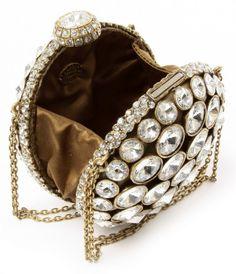 Winner of Independent Handbag Designer Awards 2011 for InStyle Red Carpet Ready Evening Bag! Hand sculpted metal, open work design embellished  with round shape SWAROVSKI® ELEMENTS crystals (400×465)
