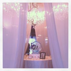 What a great spot for an ice sculpture eh? We love the draping and chandeliers to frame it. #wedding #decor #lighting