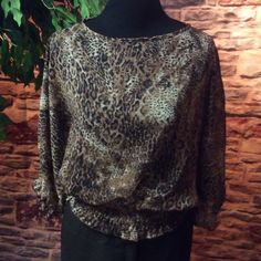 SUSHI FLOWER SEMI SHEER 3/4 SLEEVE LEOPARD BLOUSE Pretty lightweight blouse with elastic band at the bottom and sleeves. Leopard print Sushi flower Tops Blouses