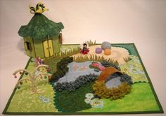 Bad weather? Sick kid? No backyard? No problem. Bring the fairy garden INSIDE. This one is made out of fabric. Their houses open up, too. So adorable. These are Fantasy Fairy Garden play quilts. They come in different designs. Too cute.