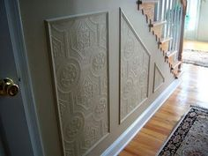 Such a seemingly simple way to add so much character and originality to a home!  How-to: Faux carved wainscoting using textured wallpaper
