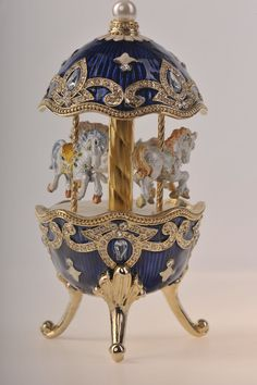 Faberge Egg with Horse Carousel via Etsy. It's a tiny dream within an egg.