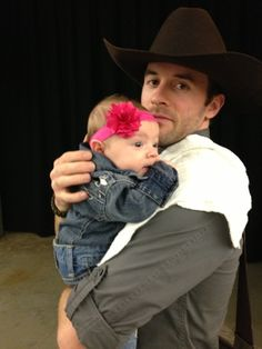 A cowboy and his little cowgirl!