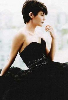 Audrey Tatou  in a black silk dress  rocks + also sweet