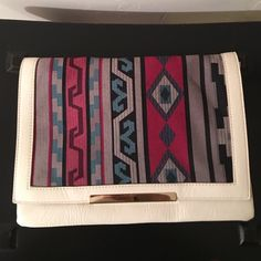 Aztec print faux leather clutch Faux white leather clutch with Aztec print detail . Interior zip pockets and cell phone pocket. Condition is like new! Forever 21 Bags Clutches & Wristlets