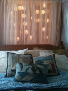 "like the idea of using lighting (muted/diffused, not the string lights) behind the ""curtain"" that the headboard will be up against."