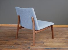Jason Lewish Furniture, C07 - armless lounge chair with hardwood frame and upholstered seat. $1650