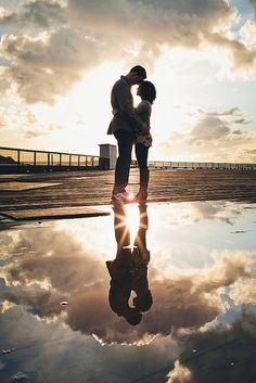 Wonderful reflection shot, I hope it rains for my next engagement shoot! :)