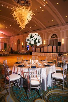 Classic Wedding Reception With Navy, White and Ivory Centerpieces, Silver Chiavari Chairs and Chihuly Chandelier | St. Petersburg Wedding Venue Vinoy Renaissance | Limelight Photography