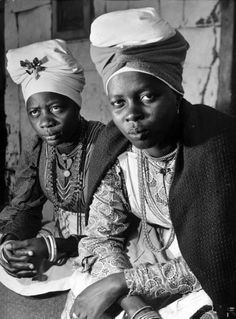 Herero women wearing traditional turban which is put on at the age of 18 signifying readiness for marriage. Photograph by Margaret Bourke-White. Windhoek, South Africa, April 1950.