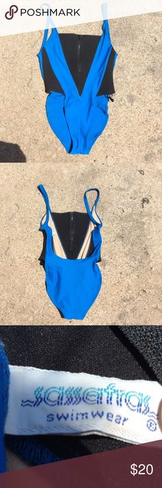 Super cute neoprene one piece size large Very cute, has been worn quite a bit! It has a little bit of piling and I'm going to try my hardest to remove that. The black parts of the swimsuit are neoprene, the blue is regular swimsuit material! The bottoms are very high cut, it reminds me of the very popular body glove swimsuit that Kylie Jenner wore.If you have any questions or concerns please comment down below! triangl swimwear Swim One Pieces