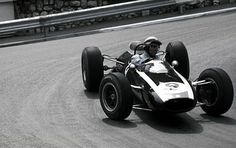 Phil Hill, manhandling a Cooper-Climax in 1964