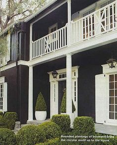 I love the tress and deck on the front of this house! One day I'll have that dream home...