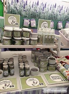Handmade lavendar products displayed on a tabletop shelf.