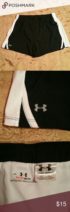 "NWOT UA Under Armour Heat Gear Athletic Shorts New without tags - fabric content tag in pics - built in panty - elastic drawstring waist - breathable mesh panel sides - black, white and silver - hidden pocket on back waistband - 14"" overall length - 4"" inseam Under Armour Shorts"