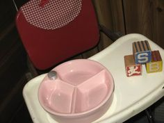 Remember the baby dish that you filled with hot water to keep the food warm?...with suction cups to stick to the highchair tray?