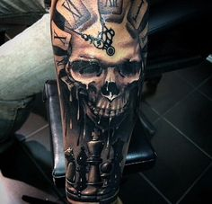 Skull tattoo with chess board