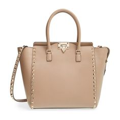 'rockstud' leather double handle tote by Valentino. Just the right size for carrying yet not too small to accommodate your essentials, the Rockstud tote will carry you t...