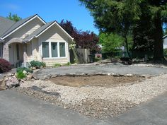 1/4- packed down and normal River rock  put in place on outside of raised yard border.
