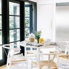 Ikea Docksta Table with White Wishbone Chairs