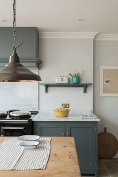 Shaker canopy and base cupboards by deVOL in the lovely Hampton Court Kitchen