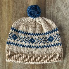 The perfect hat to run around in the snow with a splash of color and a pom pom for a bit of fun.