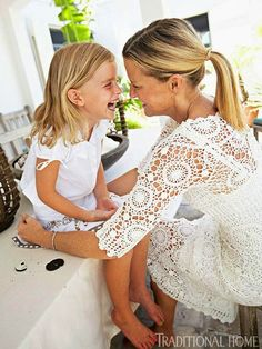 """""""India shares a laugh with Domino, who was named for the 'Bond girl' in the movie Thunderball, which was filmed in the Bahamas."""" Hibiscus Hill, the Bahamian home of India Hicks, David Flint Wood, and their children. Photography by Colleen Duffley. """"Model, Designer India Hicks' Home in the Bahamas"""" written by Rebecca Christian. Traditional Home."""