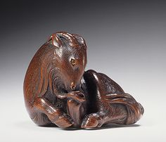 Ikkan (Japan, Nagoya, 1817 - 1893)   Goat, mid- to late 19th century  Netsuke, Wood with double inlays. LACMA