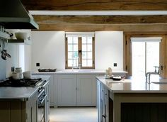 another kitchen idea, I like the low ceiling here with the exposed beam